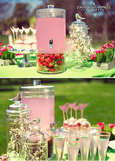 love the strawberries in the bottom and the simple sprig of flowers in the jars