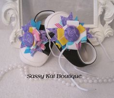 ~Unique shoes you cannot find anywhere else~DELILA BABY SHOESThese sweet little shoes are made of the sturdy canvas with cushioned insides and non-skid soles.  The shoes lace up to stay securely on baby's foot. The laces hold handmade shabby chic flowers made from coordinating cotton fabrics.  Made to match the Delila line.Available in 3 adorable colors