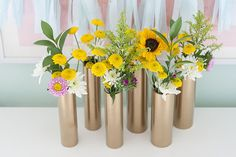 Make a Modern Spring Centerpiece Using Just Gold Spray Paint and PVC Pipe (hidden glass or vase inpipe for water)   eHow Home