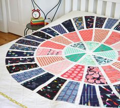 Bullseye quilt  done in Dresdens. should work up pretty quickly into a large bed quilt size. templates on there for free.