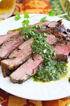 Grilled Marinated Flank Steak with Chimichurri Sauce. Wish we'd marinated the steak longer than 2 hours, but the marinade combined with the chimichurri were delish! Meat Recipes, Whole Food Recipes, Cooking Recipes, Healthy Recipes, Cooking Time, Mayonnaise, Chutney, Steak With Chimichurri Sauce, Marinated Flank Steak