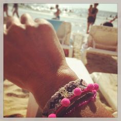 #danalevy mini hamsa hand charm pom pom midi friendship bracelet looks fabulous in the summer with a tan!
