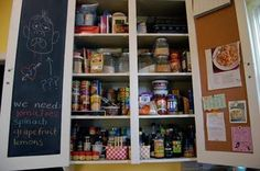 Here's a shot from Craftzine. Yet another chalkboard paint creation. I love that you can hide all of your uglies behind your cabinets. That way no one sees when you have tampons on your shopping list.  Maybe glue in galvanized metal and cover it with magnets instead of the cork.