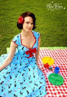 Heidi Dress in Cat Print with Red Bow - Our Heidi is the cute sister to our Natasha dress. Perfect for any season, this swing dress has a slightly shorter hemline, an absurdly flattering gathered bustline, contrast trim, and an over-sized bow is the icing on the cake.  Made from the highest quality stretch sateen in Pinup Coutures exclusive fabric design by Joe de Blois.