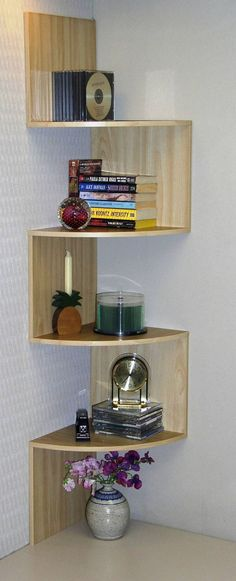 Corner Spacesaver Bookcase - Curved shelves add interest. Maybe in my kitchen? I have a corner sink, so much wasted space there. Make it decorative!