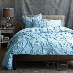 Organic Pintuck Duvet Cover and Shams in Sea by west elm. In case I decide to go the more formal route.