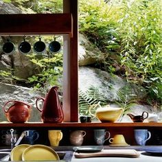 Dark blue or apricot Russell Wright serving dishes and largebowls    Russell Wright House, Manitoga NY