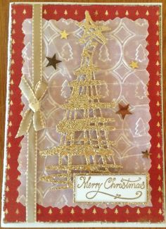 Designed and made by Gail using Tim Holtz Thinlits 'Festive Scribbles' dies, glitter card stock, velum and embossing folder.