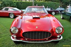 Ferrari 375 AM Berlinetta Speciale 1955 SN 0490 AM This all-aluminium bodied 375 AM was made for the 1955 Turin Motor Show as a showcase of Ferrari's savoir-faire. Its engine is a 3.4 l Lampredi V12 delivering 340 bhp. Originally painted in white with a black roof, its design introduced the small fins on the rear fenders and the louvres in the window, which announced the later 1957 design of the 250 GT Tour de France.