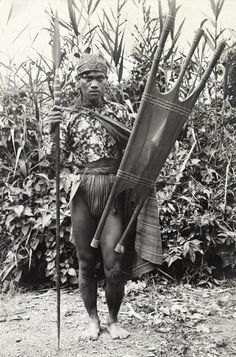 602795. A Kalinga warrior stands with his spear and shield.