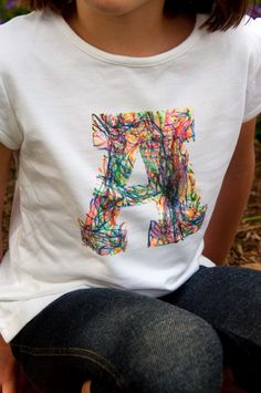 Aesthetic Nest: Craft: Scribble Initial T-Shirt (Tutorial) from aestheticnest.com. What a fun craft using sharpie fabric markers and freezer paper! Our little girl would love it!