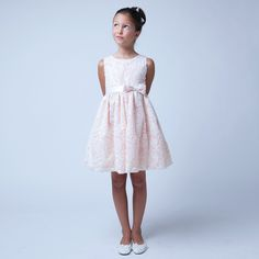 This might be the perfect Easter special occasion dress for your little girl from Sweet Kids. It is peach and features a sequin rosette embroidered mesh and a bow accent at waistband. Add this to her wardrobe for a touch of cute flair.