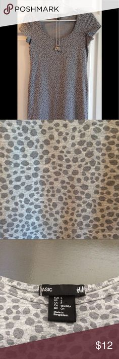 H&M Body Con Grey Animal Print Dress/Tunic Top EUC Flattering style to be worn as a dress with heels for a night out or layered over leggings and flats for a casual look.  Form fitting cotton blend. Animal print is never out of style! H&M Tops Tunics