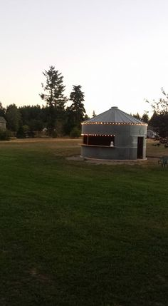 Grain BIn converted to a bar, Silo, Wedding Bar, Silo Bar, Outdoor Kitchen - We turned an old grain bin/silo into the bar for our sons wedding. Here it is almost complete Ponds Backyard, Fire Pit Backyard, Backyard Landscaping, Outdoor Fire, Outdoor Living, Silo House, Harvest Farm, Grain Silo, Outside Room