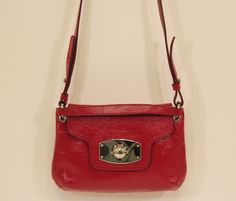 Furla-Red leather crossbody made in Venice Italy. Can be found at (www.handbagconsignmentshop.com)