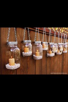 Candles in jars with beans hung by chains - cute idea for outside during summertime. Could just not hang them and place them right on the deck. Oooh ideas here.