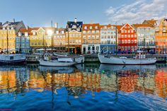 Copenhagen is the capital of Denmark, which often tops those happiest-places-on-Earth lists. Here's what you should know to bring the joy to your trip. Copenhagen Travel, Copenhagen Denmark, Denmark Europe, Copenhagen Hotel, Places To Travel, Places To See, Capital Of Denmark, Destinations, Voyage Europe