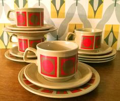 These red and gold Mid Century Modern tea cups, saucers and side plates would help make for a festive vintage table this holiday season!