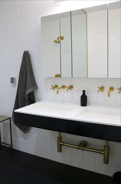 Brass fixtures and clean lines are carried throughout the home.