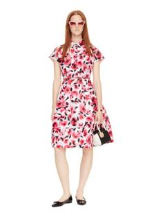 everything's coming up roses: this pretty print, an un-fussy floral, is sure to put a spring in your step (even in the dead of winter). the bright blooms serve as a feminine counterpoint to the shirtdress' structured shape, for a look that's equal parts chic and cheerful.