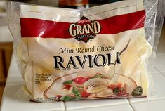 Lazy Girl's Ravioli Lasagna. Use frozen cheese ravioli instead of boiling noodles and mixing a cheese filling. SO much easier, and just as delicious! | iowagirleats.com