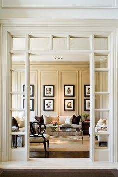 great formal living room, I love the archway.  Definitely wait for this until the kids are older.  Entry & paneled wall love them