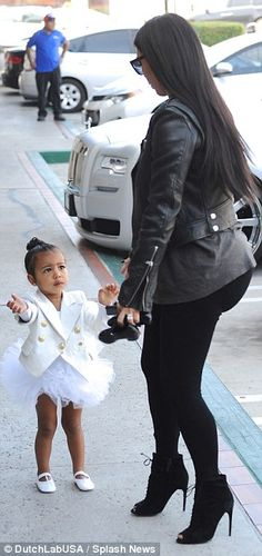 North West the prima ballerina wears white tutu and custom Balmain jacket to dance class with Kim Kardashian  | Daily Mail Online