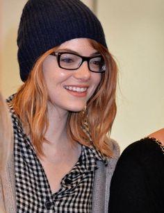 Emma Stone wearing square glassses