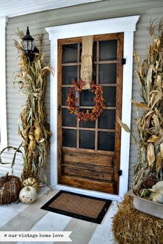 our vintage home love: Fall Porch Ideas. I actually like this screened door