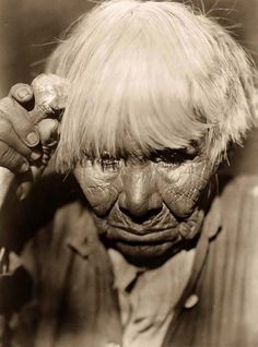 """Old Woman Mourning"" - took in 1924 by Edward S. Curtis of a Yuki Indian woman."