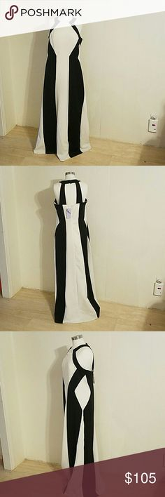Eden Black/White Halter Gown Elegant yet sexy, the halter neckline oozes femininity with a flirtatious appeal makes it ideal evening wear for any formal occasion. Eden  Dresses Maxi