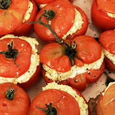 For these buttery-soft roasted tomatoes, Alain Coumont boosts the flavor of the creamy goat cheese filling with garlic and basil. The result works bot...
