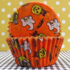 Cute classic orange halloween baking cups printed with ghosts, jack o lanterns, witches, black cats and bats!
