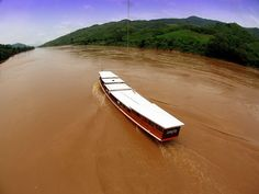 Travel by riverboats in Laos. 'Travelling on riverboats is a highlight in Laos, but when the water level is low you might have to get out and push!'