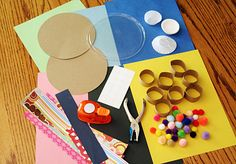 """Round Art -Materials:      colored construction paper     cardboard circles (cut from a cereal box)     round plastic lids     mini cupcake papers     cardboard tube """"slices""""     pom poms     dot stickers (from the office supply store)     circle punch     hole punch     strips of scrapbook paper (for punching or whatever!)     basic supplies: glue, scissors, something to draw/color with"""