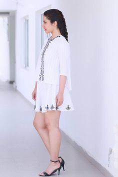 Tollywood Glamours Hot Rashi Khanna Legs Show Photo shoot In White Mini Skirt
