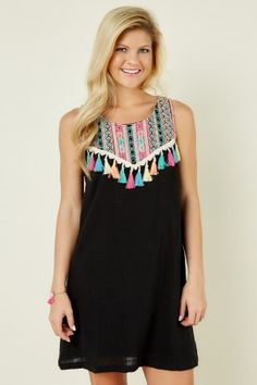 How fun is this dress! Casual and stylish perfect for dinner out with friends.