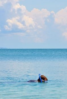 Snorkeling along the colorful coral reefs of Costa Rica's Caribbean Coast. 14 more awesome things to do in Costa Rica here: http://www.twoweeksincostarica.com/costa-rica-travel-inspiration/ #CostaRica #travel #travelinspiration