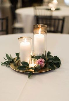 For a no fuss decor idea make these DIY simple + elegant centerpieces. – Brit Morin For a no fuss decor idea make these DIY simple + elegant centerpieces. For a no fuss decor idea make these DIY simple + elegant centerpieces. Simple Elegant Centerpieces, Purple Wedding Centerpieces, Elegant Table, Inexpensive Wedding Centerpieces, Diy Wedding Table Decorations, Non Flower Centerpieces, Floating Candle Centerpieces, Cheap Table Centerpieces, Vintage Centerpieces