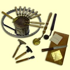 TECHNOLOGY (evolution of hand tools): Bookbinder's traditional gold-tooling tools, with gold leaf