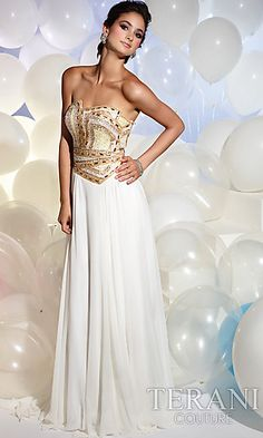 This classic strapless gown for prom is given a modern updated look with a unique neckline and dazzling beadwork. A lovely long ivory or pink prom dress featuring a strapless bodice with sparkling crystal beadwork that looks like modern art made wearable. Get the perfect look for your prom or special occasion with a strapless prom gown from Terani's 2012 prom dress collection.