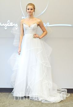 """Brides.com: . Trend: Cool Tulle Skirts. Style 6457, """"Byron"""" sleeveless lace mini wedding dress with a handkerchief tulle A-line overskirt, v-neckline, and spaghetti straps, Hayley Paige"""