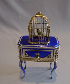 singing bird box in silver gilt, iridescent blue guilloche enamel and ivory. This is a German experimental piece by Karl Griesbaum himself. So expensive to make it never went into production. German circa 1920. 8.5 inches high by 4.25 inches wide by 2.5 inches deep ( 20 cms by 10.5 cms by 6.25 cms).