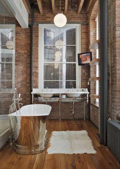 Bathroom, wooden floor, brick walls and shiny vintage bathtub!