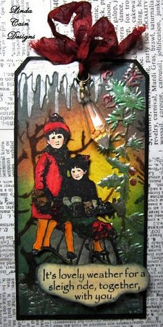 I just can't take how amazing this tag is using artistic outpost sleigh ride stamps and Linda Cain's artistry.