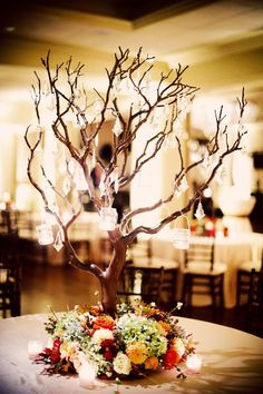 Beautiful tree centrepiece with hanging crystals {by Hydrangea Floral}. A nice table decoration for Yule x Tree Branch Centerpieces, Wedding Table Centerpieces, Flower Centerpieces, Wedding Decorations, Table Decorations, Manzanita Centerpiece, Branch Decor, Centrepieces, Centerpiece Ideas