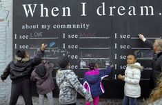 Residents share dreams for their community on giant chalkboard