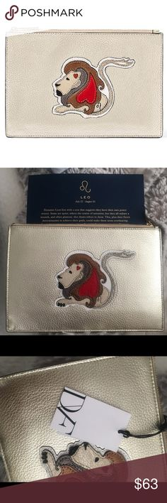 "DVF ZODIAC ""LEO"" CLUTCH NWT New with tag! Gorgeous leather clutch. Never worn. Has a lion on the front which is cute for going out or for makeup! Diane Von Furstenberg Bags Clutches & Wristlets"