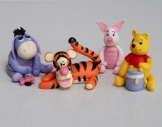 Winnie the Pooh, Eeyore, Tigger and Piglet - Cute cake topper tutorials available from Fancy Cakes by Linda, Stevenage, Herts, United Kingdom. You'll find this Cake Appreciation Society Member in our Directory at www.cakeappreciationsociety.com