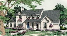 This European style home details many design accents including arched windows, hipped dormers, and planter boxes.